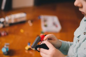 Kid building with Lego blocks