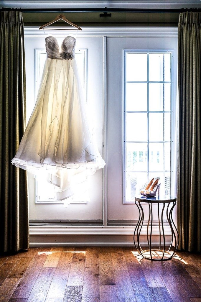 Wedding dress handing on curtain rail