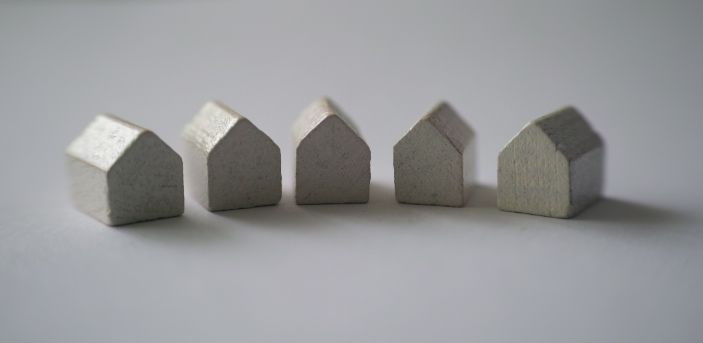 Five small grey model houses