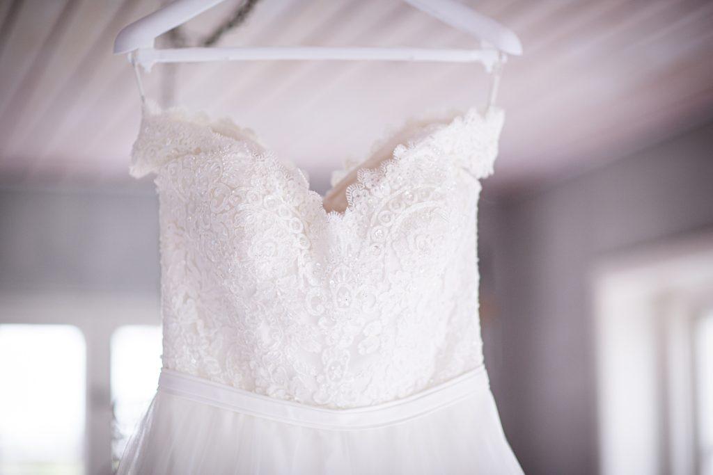 White wedding dress on clothes hanger