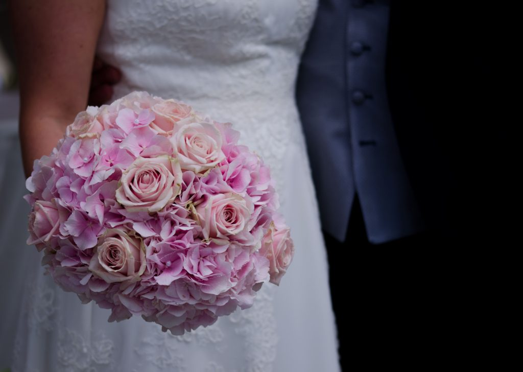 Wedding dress with pink bouquet