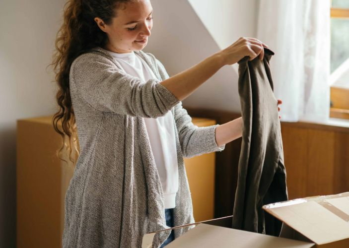 student unpacking her clothes